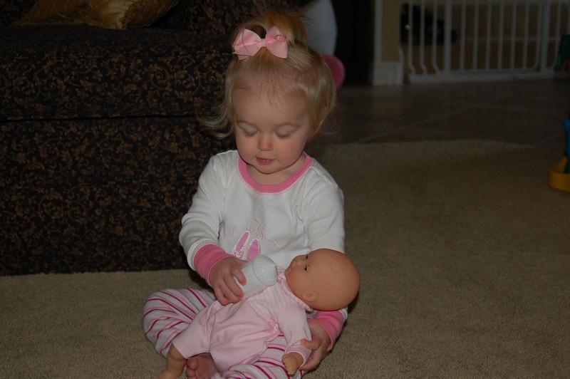 Birthday girl feeding her baby