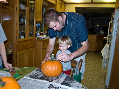 10/29 Cody helps cut the top of the pumpkin.