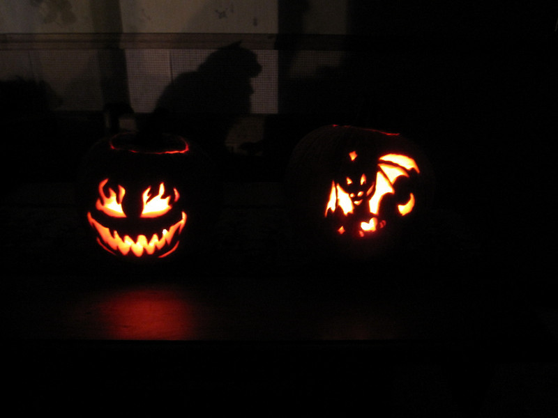 Pumping carving time. Carrie and I's on the left, Kyle and Jo's on the right.  Momma kitty's shadow in the background.
