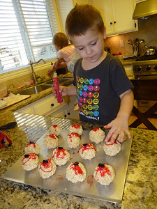 Joey making Bloody Eyeball cookies