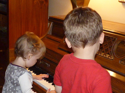 Cambria likes to play the piano -- Joey helps