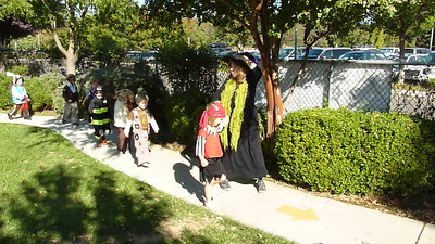 Miss Jackie leads the presc hool Halloween parade