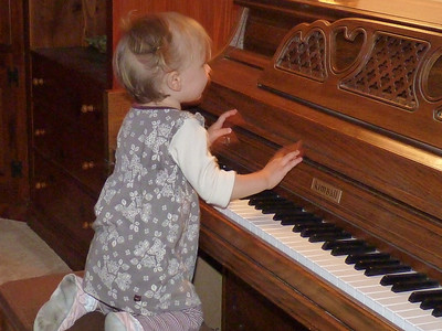 Cambria likes to play the piano