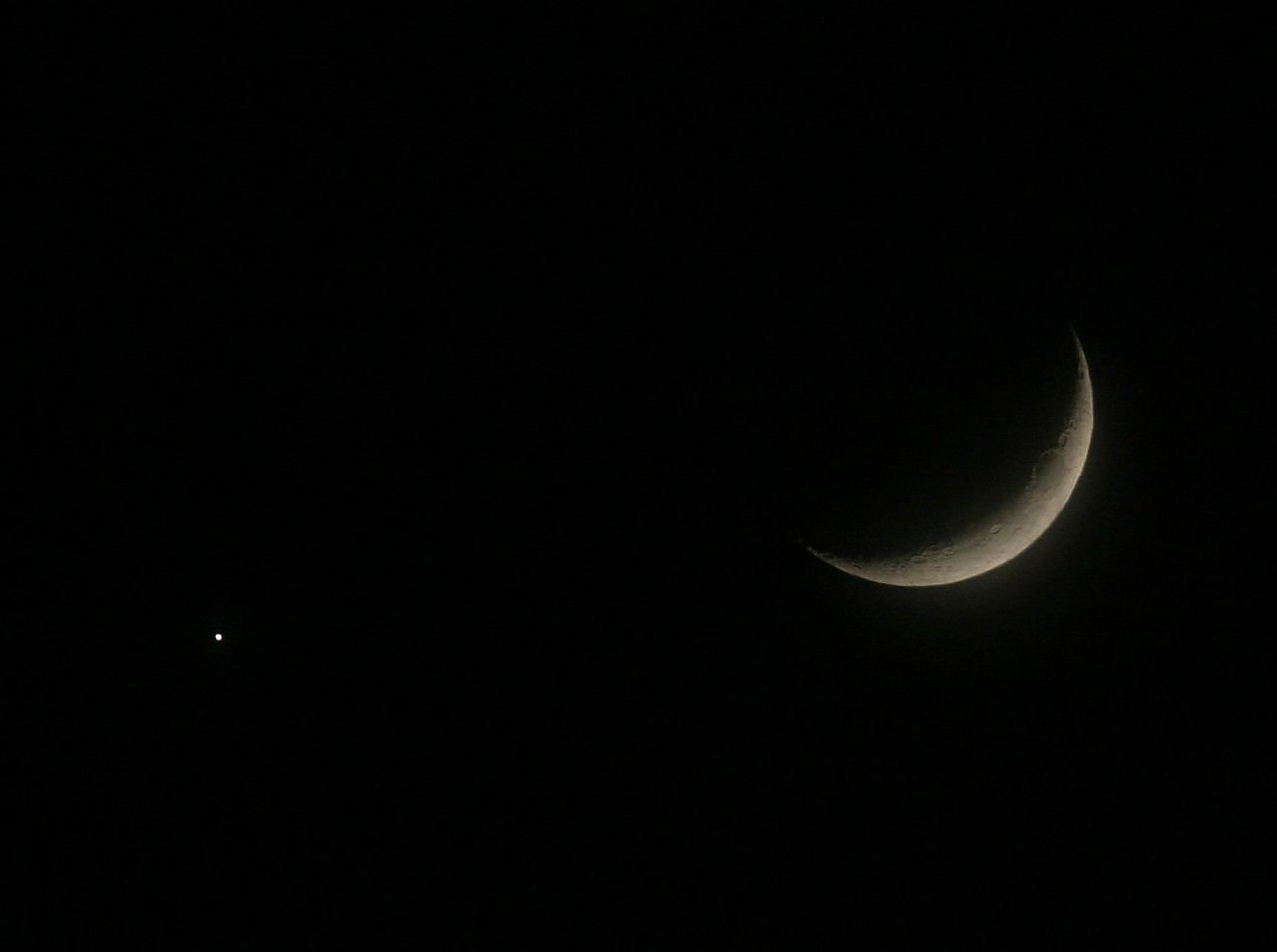 The Moon and a Star or planet doing a weird formation. <br /> For an excellent close up of the moon you must view photo in the Origonal size. Pretty good for handheld shot.