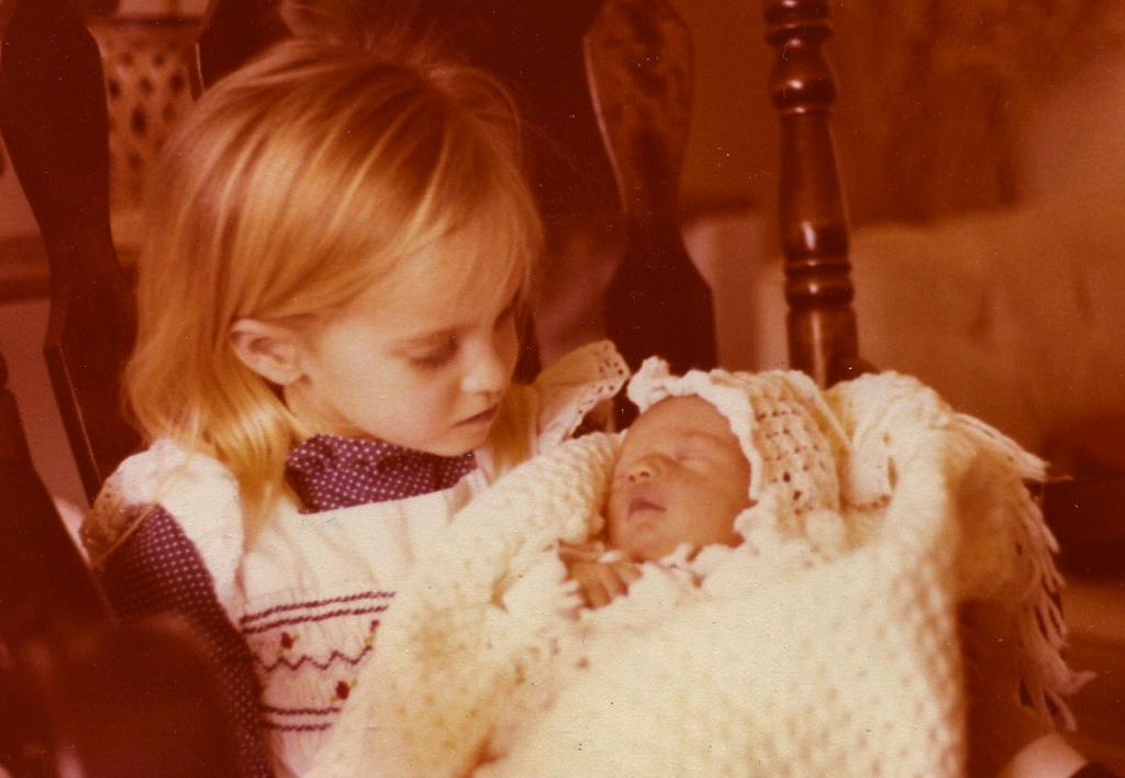 March 14, 1979 - Allison holds her new sister, Erin