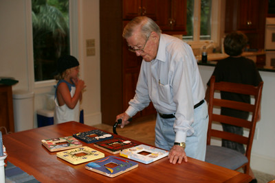 Daddy trying to judge the frame contest