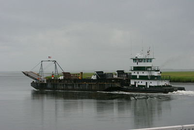 Tugboat pushing the barge