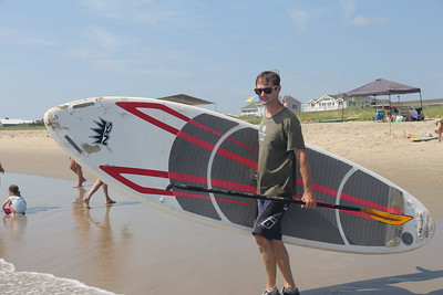 Drew heads into the ocean with his board