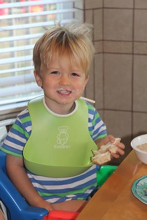 one happy boy having breakfast