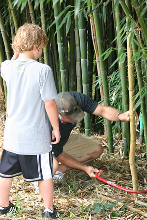 Chris instructing Wyatt in sawing technique