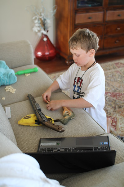 """Aaron needed more guns - he is using the bananagrams tiles for something in this """"head"""" game"""