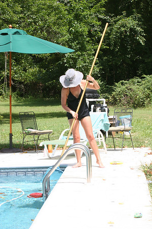 Caroline cleans the pool