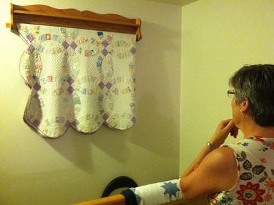Deb told us about her grandmother Yarrow's quilt, displayed here by the stairway.
