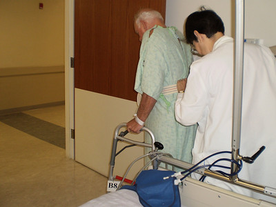 First walk with Physical Therapist guiding him