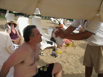 John gets a facial spritz at the beach