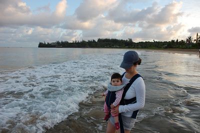 Tam & Hannah in Hanalei bay at sunrise- Princeville in the background.