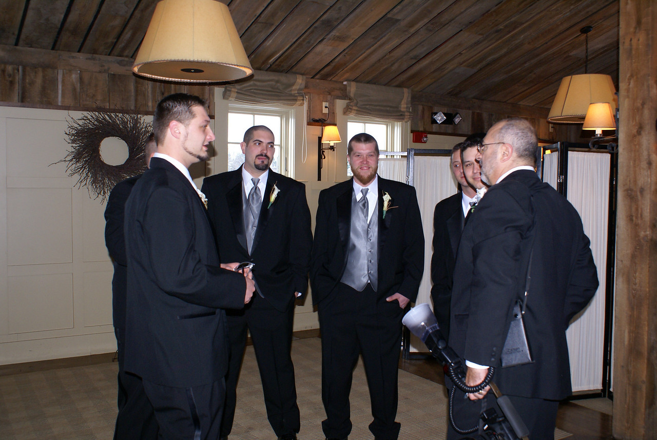 The groom, Matt on left, and his groomsmen discuss the events with the photographer.