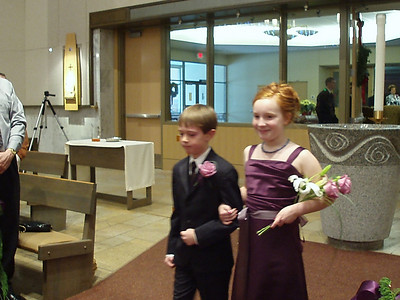 Junior groomsman and bridesmaid, Evan and Lucy