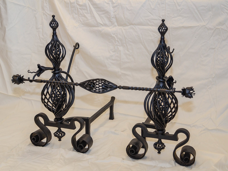 """Antique andirons after being electrostaticlly """"powder coated"""" black after being sand blasted."""