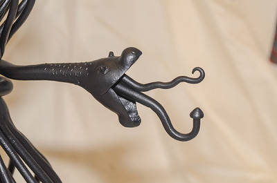 "Antique andirons after being electrostaticlly ""powder coated"" black after being sand blasted."