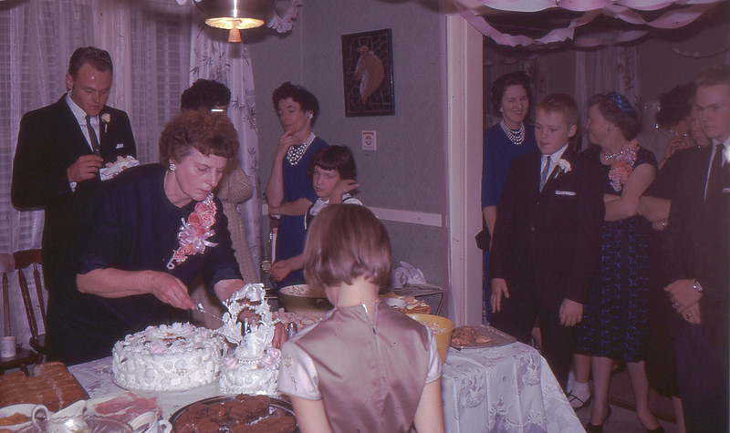 Mother of The Bride Serves Wedding Cake