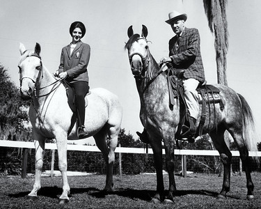 Helen Whittington and John A. Whittington, Jr. riding horses Nov. 30, 1965