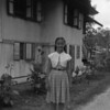Helena in front of our house in Sibou (1955)