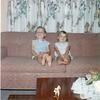 Smiling Suzette & Jjosie on couch-7