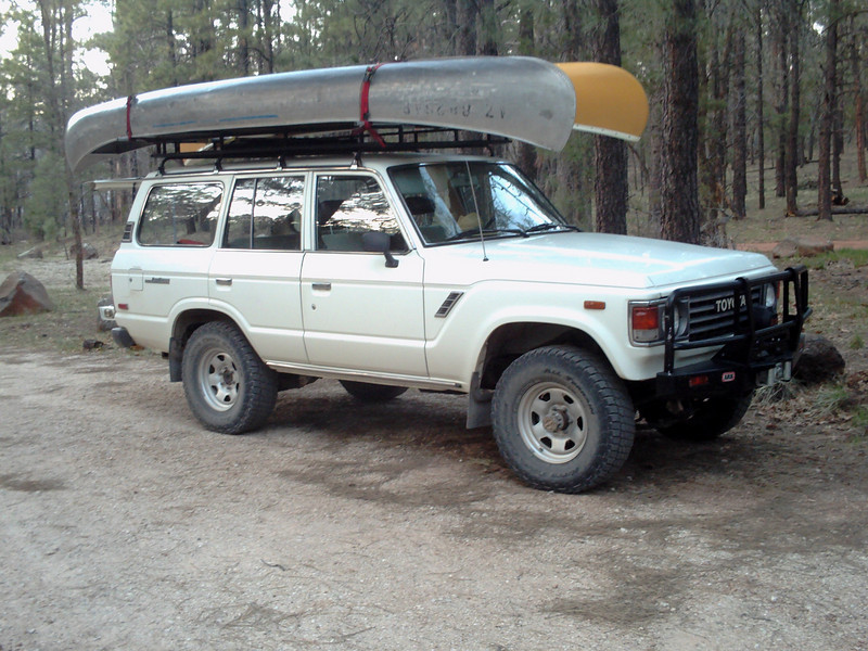 Mike's FJ60 loaded with the sweet Grumman and Old Town canoes.