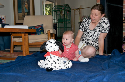 Mom and daughter entranced by the singing dog.