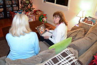 Eivor and Greta look through Kristi's annual calendar a wonderful gift..
