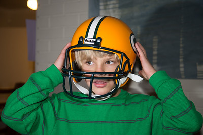 Grant in his Green Bay Packers helmet,Clay Mathews is his favorite player.