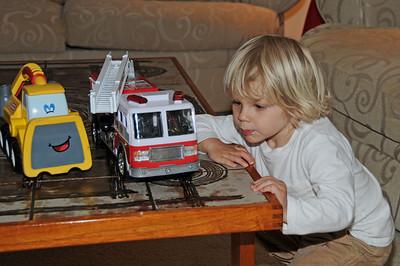 Grant studies his favorite fire truck.