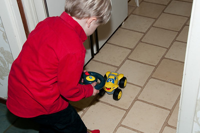 The remote control car goes back and forth and has working lights and a horn.