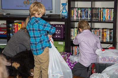 Saxon and Grant prepare to open presents