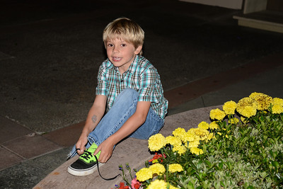 Grant ties his shoes outside the restaurant.