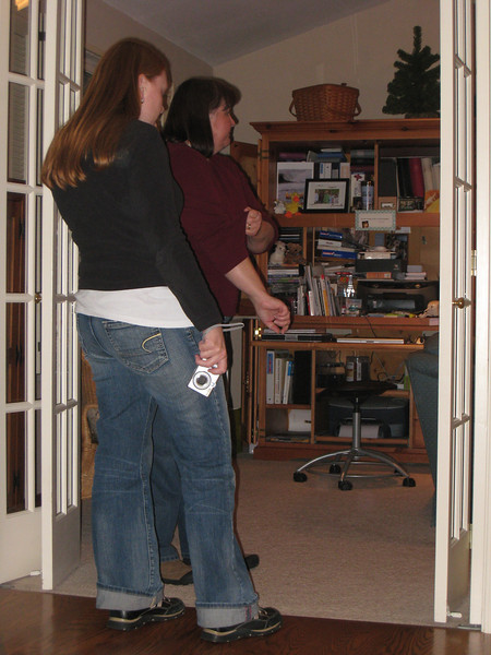Mom and Jen supervise the gift gathering.