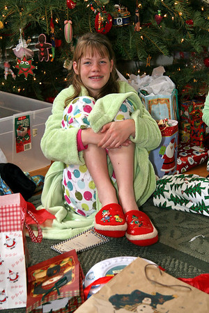 Emilies gets new slippers with Swiss Monkeys on them.