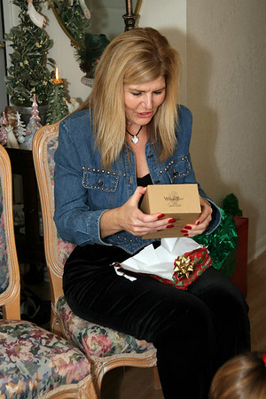 Chris's Aunt Lissa opens a Willow Tree gift.