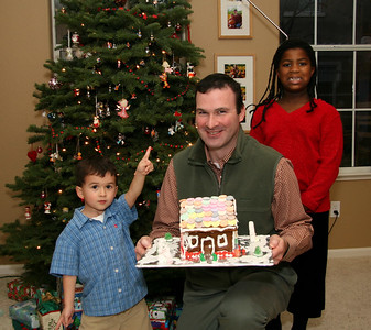 James and friends with his gingerbread cabin.   Kyle proclaims that James' gingerbread house is Number One!  Or, there's something on the ceiling.
