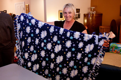 Tania models the first of seven charity blankets.