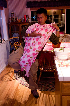 "Greg, uh, ""models"" the pink blanket. Would not relinquish it afterwards."
