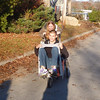 Fred wheeling Max in the dog stroller