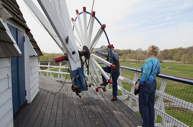 """Humpy"" demonstrating how miller moves angle of windmill blades or sails into direction of wind"