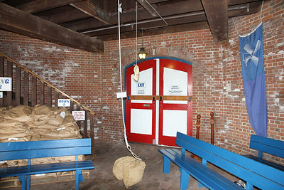 First floor of grist mill. Note the wooden shoe on rope which is used to send messages to upper floors
