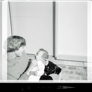 Enid Holmes & Anthony Holmes at 46 Windsor Avenue, Mount Waverley, 1964.