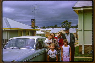 Type: Kodachrome. Number 18 (black) Jan 65M. Rear: Sue Holmes (baby), Winifred (Bessie) Holmes, Betty Holmes, Charles (Dick) Holmes, (front) Peter Holmes, Anne Holmes.