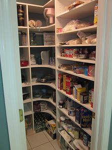 Pantry (off of kitchen.)  I absolutely love this walk in pantry. It's so convenient!