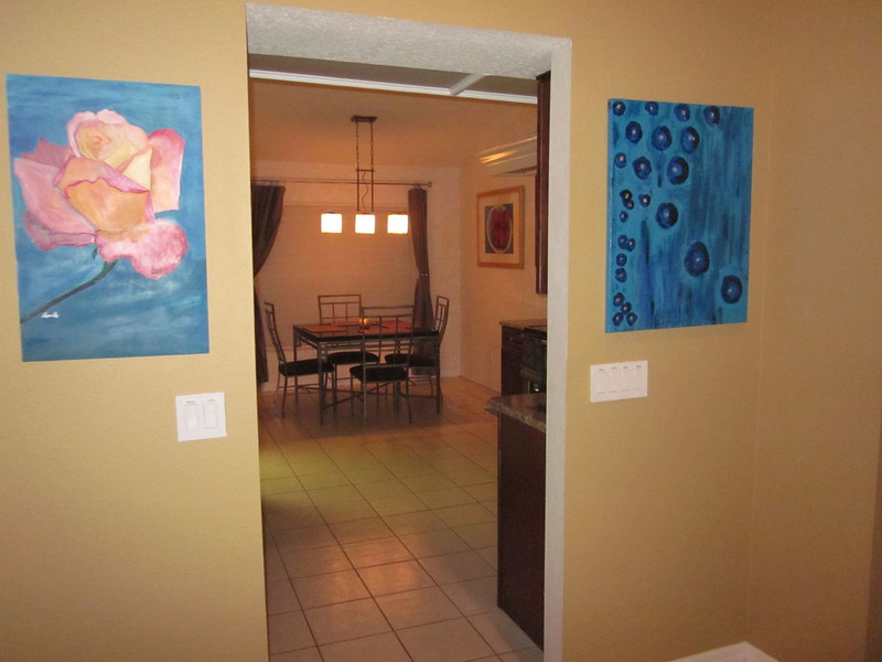 Passageway to kitchen, view of 3 original paintings.