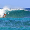 Surfer ripping it up at the Bonzai Pipeline.